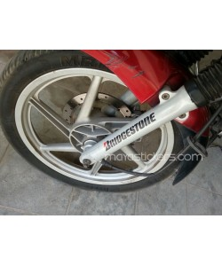 Bridgestone logo sticker on Bajaj Pulsar fork