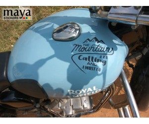 Mountains are calling sticker on Royal Enfield classic redditch blue tank