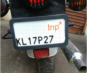Trip orange sticker on Royal Enfield number plate