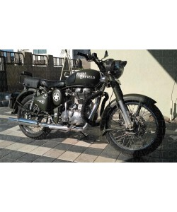 Royal Enfield old style logo sticker on tank of modified bullet