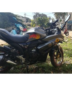 Red Bull logo sticker on Suzuki Gixxer SF SP tank