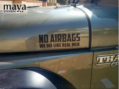 No airbags we die like real men sticker on mahindra thar