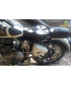 Skull and crossed guns stickering on white royal enfield classic 350 battery box