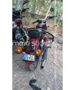 Trip sticker on royal enfield classic 350 maroon